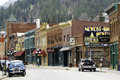 Signs at main street deadwood in south dakota wild bill hickock was shot here during a poker game Royalty Free Stock Photography