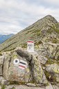 Signs on the mountain pass designation of routes and border stone a background of Stock Image
