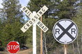 Signs at a Railroad Crossing Royalty Free Stock Photo