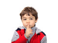 Silence child with his finger to his mouth Stock Photos