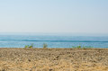 Silence seashore. Blue haze horizon view. Water blur background Royalty Free Stock Photo