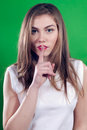 Silence sign from beautiful young woman on green Royalty Free Stock Photography