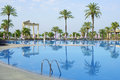 Silent morning near the swimming pool turkish hotel in summer time Stock Image