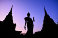 Silhouette of ancient Buddha image and old pagoda in Historic To Royalty Free Stock Photo