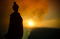 stock image of  Silhouette of Arab man stands alone in the desert and watching the sunset with clouds of fog. Eastern Fairytale