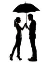 Silhouette of Asian couple holding umbrella Royalty Free Stock Photo