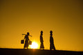 Silhouette of asian traditional farmers carrying clay pots on head going back home bagan myanmar Stock Photos