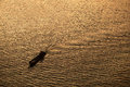 Silhouette Background  of a boat is running through a river in th Royalty Free Stock Photo