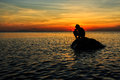 Silhouette of a boy fishing during sunset Royalty Free Stock Photography