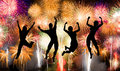 Silhouette of boy and girl jumping happy enjoy brightly colorful fireworks