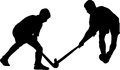 Silhouette of boy hockey players battling for possession of ball Royalty Free Stock Photo