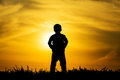 Silhouette boy on sunset Royalty Free Stock Photo