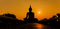 Silhouette buddha of statue in sunset thailand Royalty Free Stock Photography