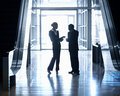 Silhouette of business people standing together Royalty Free Stock Photo