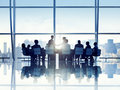 Silhouette of Business Person in a Board Room Royalty Free Stock Photo