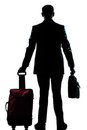 Silhouette business traveler man with suitcase Stock Photography