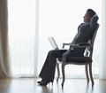 Silhouette of business woman sitting with laptop Royalty Free Stock Photos