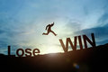 Silhouette of businessman glowing jump Lose to Win. success conc Royalty Free Stock Photo