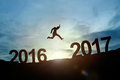 Silhouette of businessman glowing jump 2016 to 2017. success con Royalty Free Stock Photo