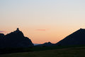 Silhouette of a castle on a hill, at sunset Stock Photos
