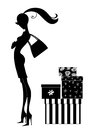 Silhouette of a chic young woman shopping girl with pretty boxes Stock Images