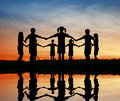 Silhouette children. sunset pond. Royalty Free Stock Photo