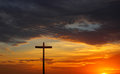 Silhouette of Christian cross over red sunrise or sunset Royalty Free Stock Photo