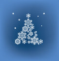 Silhouette of christmas tree formed by snowflakes background with Royalty Free Stock Photos