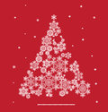 Silhouette of christmas tree formed by snowflakes background with Stock Image
