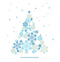 Silhouette of christmas tree formed by snowflakes background with Stock Images