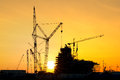 Silhouette of construction site in sunset time Royalty Free Stock Photo