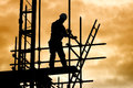 Silhouette construction worker on scaffolding building site Royalty Free Stock Photo