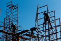 Silhouette of construction workers against sky on scaffolding wi Royalty Free Stock Photo