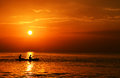 Silhouette couple canoe sunset caribbean sea Stock Photography