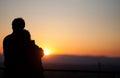 Silhouette of couple enjoying sunset over freiburg germany Stock Photo