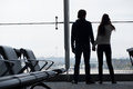 Silhouette of a couple holding hands and waiting at airport terminal this image has attached release Royalty Free Stock Photo
