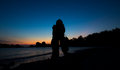 Silhouette of couple hug on the Beach after sunset