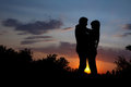 Silhouette of a couple at the sunset Royalty Free Stock Photo