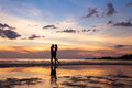 Silhouette of couple on sunset beach Royalty Free Stock Photo