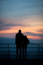 Silhouette of couple in sunset sky Stock Photo