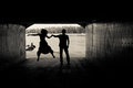 Silhouette of a couple in a tunnel Royalty Free Stock Photo