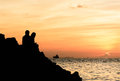 Silhouette of a couple watching a colorful sunset Royalty Free Stock Photo