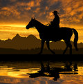 Silhouette cowboy with horse in the sunset Royalty Free Stock Image