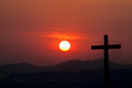 Silhouette of cross over sunset background Royalty Free Stock Photo