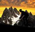 Silhouette of the cyclist riding a road bike in italy alps Royalty Free Stock Photography