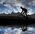 Silhouette cyclist riding road bike sunset Royalty Free Stock Photo