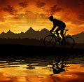 Silhouette of the cyclist riding a road bike at sunset Royalty Free Stock Images