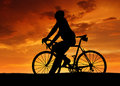 Silhouette of the cyclist on road bike at sunset Royalty Free Stock Photo