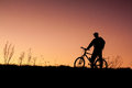 Silhouette of a cyclist with sunset background see my other works in portfolio Stock Image