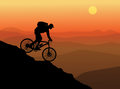 Silhouette of a cyclist in wild mountain nature landscape Royalty Free Stock Photography